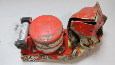 This photo shows the damaged voice data recorder of the Germanwings jetliner. The second black box, with the flight data recorder, has been found in the French Alps.