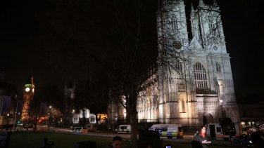 Reporters and emergency services outside Westminster Abbey next to the Houses of Parliament on Wednesday.