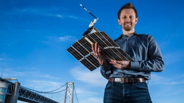 Australian physicist Chris Boshuizen with one of his small satellites.