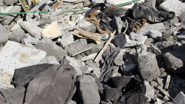 The rubble of a house which activists say belonged to al-Nusra Front after an air strike.
