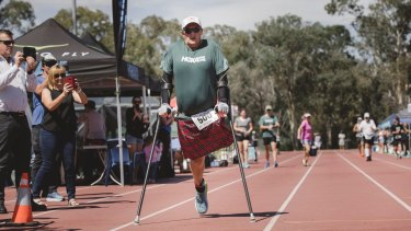 Former Winter Paralympian Michael Milton succesfully breaks the 5km record for someone on crutches.