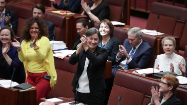 ALP Senator Penny Wong celebrates with colleagues after the Senate passes the bill.