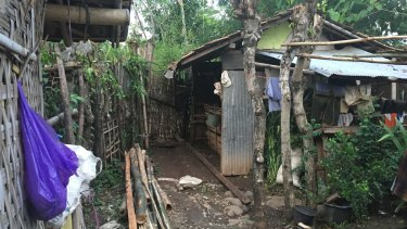 The bamboo gate leading to the area where Enja was killed.
