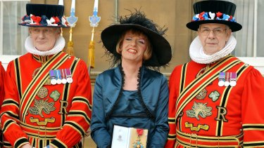 Grayson Perry reduced Prince Charles to a fit of giggles when he wore drag to receive his CBE at Buckingham Palace.