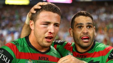 Heading back?: Sam Burgess, pictured with Greg Inglis after winning the 2014 NRL Grand Final with the South Sydney Rabbitohs.
