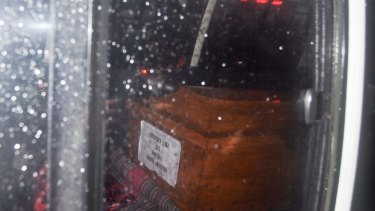 A coffin of one of the executed prisoners can be seen through the ambulance window transporting the bodies from Nusakambangan.