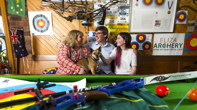 Right on target: The proud family of bronze medal winning archer Alec Potts - parents Shona and Ian,sister Emily, 13 and dog Sunny -celebrate at their Mt Eliza home.
