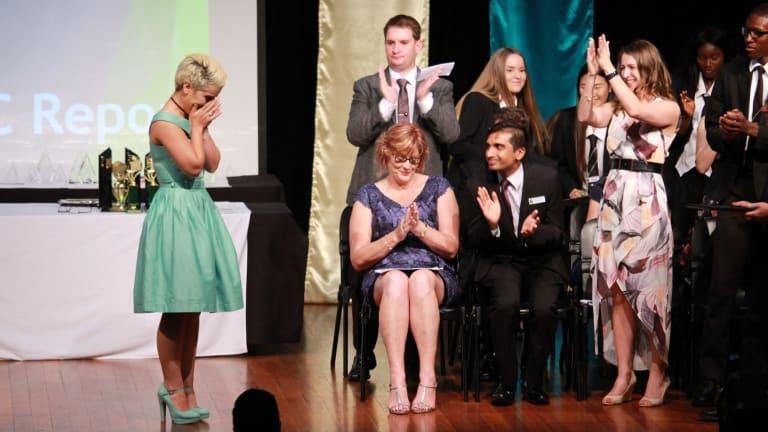 An emotional moment on stage as Mojgan Shamsalipoor graduates at the Yeronga State High School awards night.