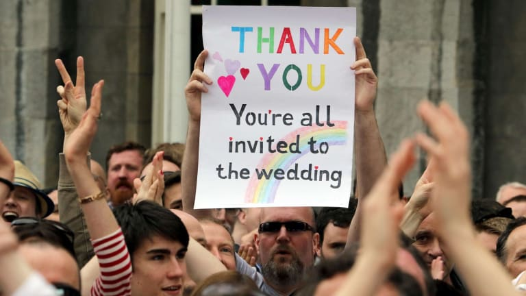 A supporter holds a sign during celebrations in Dublin.