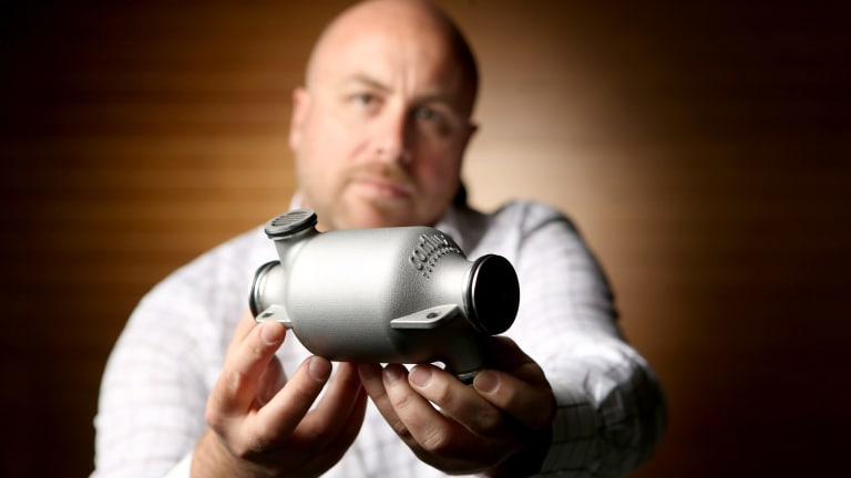 Engineer Michael Fuller shows off the 3D printed heat exchanger he has developed for Formula One teams.