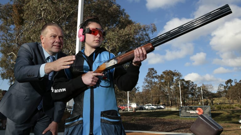 Former Olympic gold medalist Russell Mark with NSW ladies champion Tanya Skinner as she uses the new facilities that were part of the upgrade at the Majura Park Gun Club.