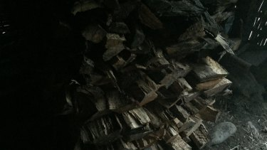 The woodpile in the home of Enja who was murdered by her brother-in-law Atmos for allegedly being a sorceress.