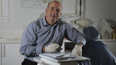 Dental surgeon Dr. Carmelo Bonanno at his Woden surgery. The surplus of dentists has been noticed far and wide.