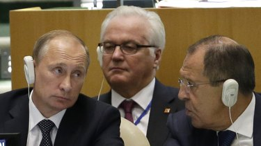 Russian President Vladimir Putin (left) with  Russia's UN ambassador, Vitaly Churkin (centre), and Foreign Minister Sergey Lavrov at the UN.