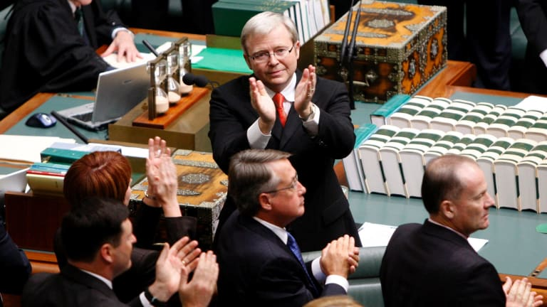 Kevin Rudd applauds members of the stolen generation in the public gallery at Parliament House after delivering his apology in 2008.