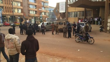Security forces gather near the hotel that was attacked.