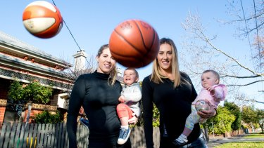 Balls in the air: Basketballer Kathleen Macleod with son Jaxon, and netballer Elissa Kent with daughter Frances.