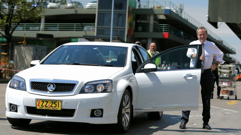 COMCARS are used by politicians for official business. In this photo opposition leader Bill Shorten uses one during a visit to the Sydney Markets in December 2015.
