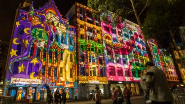 Happy return: Visitors oohed as  projections lit up Flinders Street from 9pm.