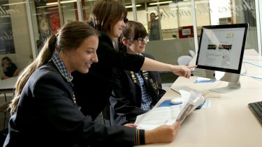 Lowther Hall VCE student Jasmine Tsiatsias (left) , teacher Carla Ziino  and student Mia Pavlatos (right) are learning about fake news in English.