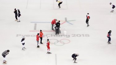 Skaters warm up during a speed skating training session in PyeongChang.