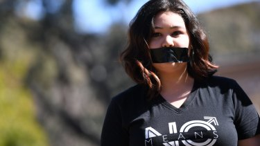 A student of the Australian National University participates in a protest after the release of the national student survey on sexual assault and sexual harassment in Canberra on Tuesday.
