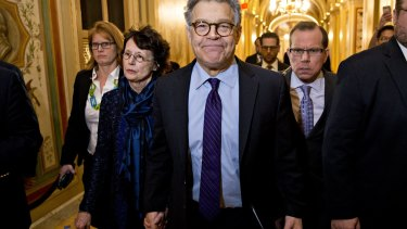 Senator Al Franken, flanked by his wife Franni Bryson, arrives in the US Capitol to announce his resignation.