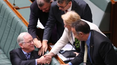 Then trade minister Andrew Robb is congratulated after he concluded the second reading debate on the China - Australia Free Trade Agreement in 2015.