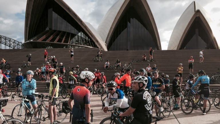Cyclists on the Mike Hall memorial bike ride at the Opera House.