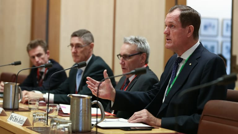 From left: The ATO's Jeremy Hirschhorn, Mark Konza, Michael Cranston and Chris Jordan appear before one of their scrutineers, the economics references committee, at Parliament House in Canberra.
