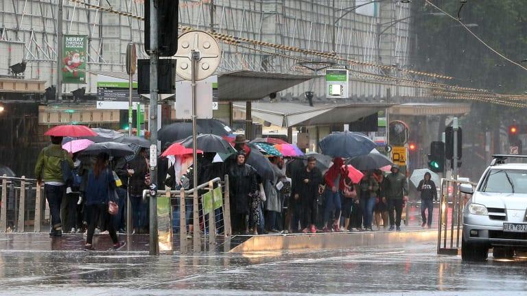 Soggy commuters in Melbourne last week.