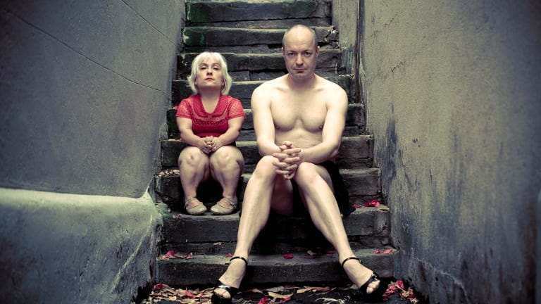 Stamell and James Berlyn on the stairs.