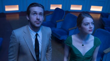 Surprise negativity: Ryan Gosling and Emma Stone play idealists struggling against reality in <i>La La Land</i>.
