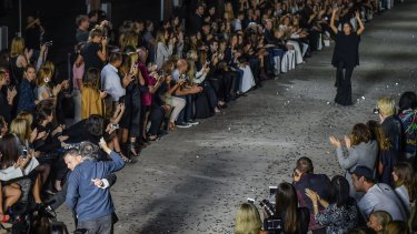 Close call: Security stopped a man from running onto the catwalk as designer Kym Ellery took a bow at the end of the opening night's show.