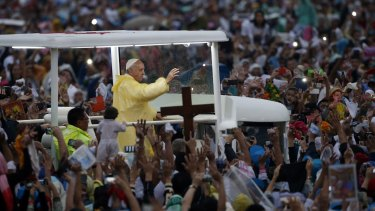 """""""We need to care for our young"""": Pope Francis waves to the crowd."""