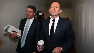 Mr Abbott tours the press gallery of Parliament House in Canberra.
