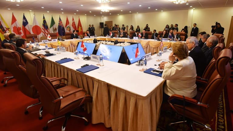 The empty seat (foreground) allocated for Canada's Prime Minister Justin Trudeau during a meeting for the Trans-Pacific Partnership.