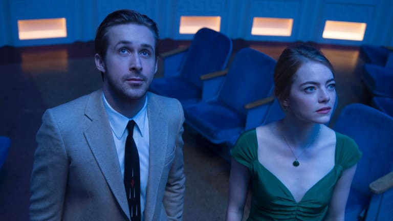 Surprise negativity: Ryan Gosling and Emma Stone play idealists struggling against reality in <i>La La Land</i>.