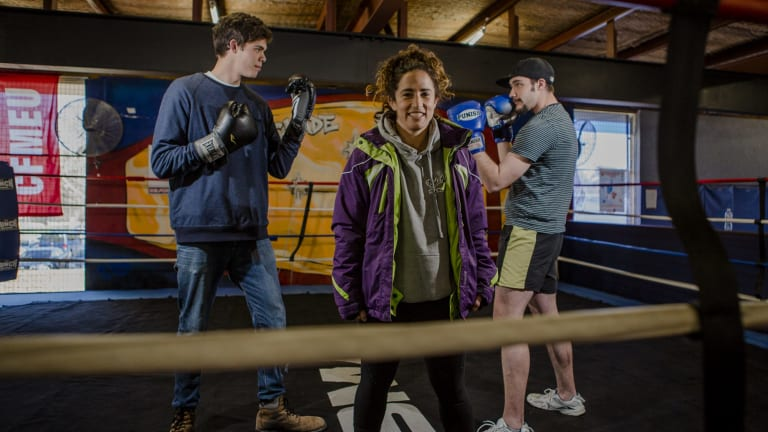 Pilot program for vulnerable youth at Stockade training centre. Front, Canberra boxer Bianca Elmir, with two students who are part of the program (from left) Michael Watt, 20, and Lachlan Thinius, 22.