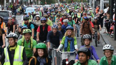 Cyclists converged on Sydney Road to pay tribute to Alberto Paulon, killed in a tragic dooring incident.