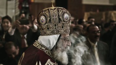 In negotiations: Coptic Pope Tawadros II, leads Christmas Eve Mass at St. Mark's Cathedral, in Cairo.