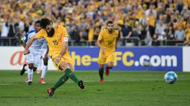 Mile Jedinak scores from the penalty spot the first time around.