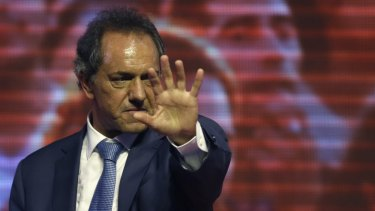 Ruling party presidential candidate and Buenos Aires Governor Daniel Scioli, greets supporters in Buenos Aires on Sunday.