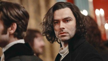 Aidan Turner gets about in a barely buttoned foofy shirt in Poldark.