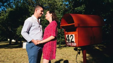 Dan Hills and Bethany Flanagan by the Love Box along the bike path in O'Connor.
