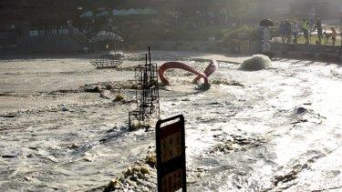 Water splashes around sculptures at Tamarama Beach.