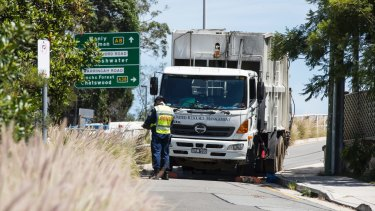 Police cordoned off an area around a garbage truck in Dee Why after a woman was hit and killed on Thursday morning.