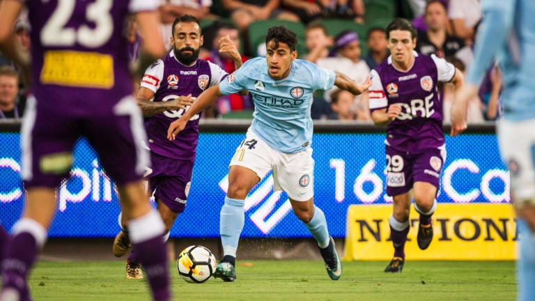 Melbourne City's Daniel Arzani takes on Perth Glory.