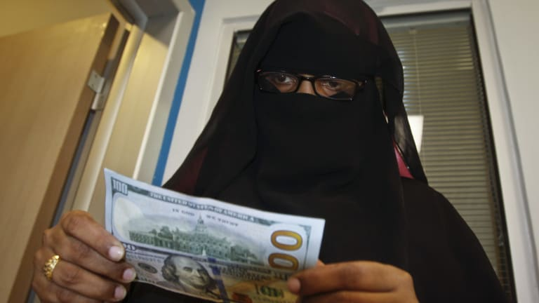 A Somali Woman Counts The Money She Collected From Transfer Service In Mogadishu
