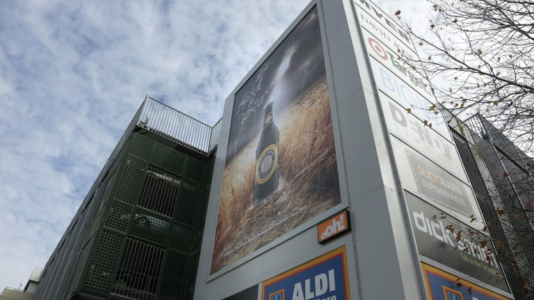 Advertisements for beer and Canberra Centre stores on the outside of the building.